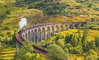 Glenfinnan Railway Viaduct with Jacobite Steam Train