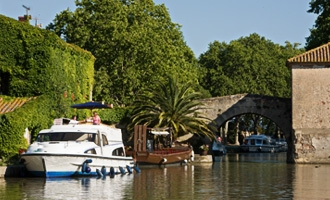 Le Boat moored in Le Somail, Canal du Midi